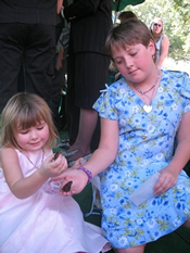 Children releasing butterflies at the funeral of their sister near West Palm Beach, FL