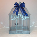 Silver and navy butterfly display cage.