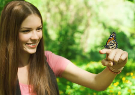 Photo shoot of young lady doing a butterfly release in Louisville Kentucky.