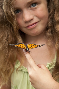 girl enjoying a monarch butterfly release in louisiana.