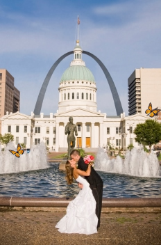 A beautiful Summer butterfly release photo shoot in Missouri. A Wedding kiss in front of the St. Louis Archway.