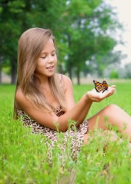 beautiful girl releases monarch butterfly near Virginia beach.