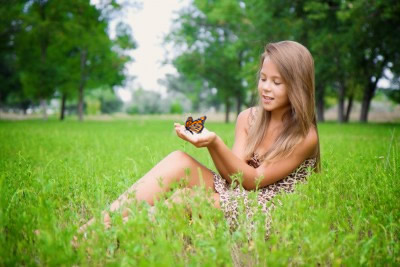 A young girl releasing a monarch butterfly in rural North Carolina